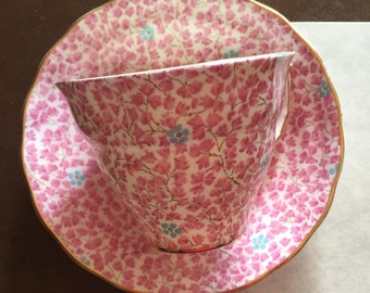 Old Royal bone china in pink leaves with tiny blue flowers teacup and saucer.