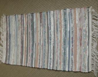 Rag rug, multi-colored real rag rug. Measures 25 by 48.  JW231