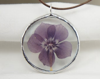 Pendant with nature flowers inside