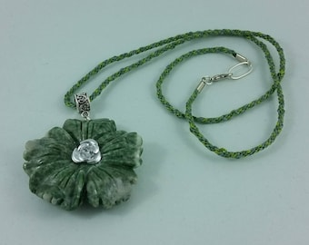 Necklace: green stone flower pendant on braided silk cord; gift for her