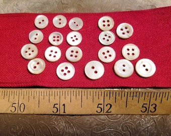 Nineteen mother of pearl shirt buttons