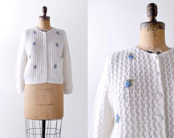 Vintage 60's cardigan. white knit. 1960's floral sweater. medium. blue flowers.