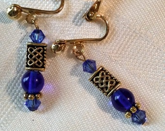 Cobalt blue, sapphire and gold clip on earrings with Celtic knot beads