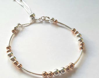 Sterling silver and rose gold beaded bracelet  with fully adjustable sliding ball clasp. birthday. bridal