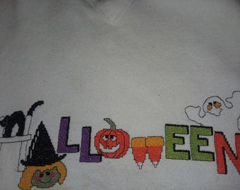 "Cross-stitched ""Halloween"" on a sweatshirt"