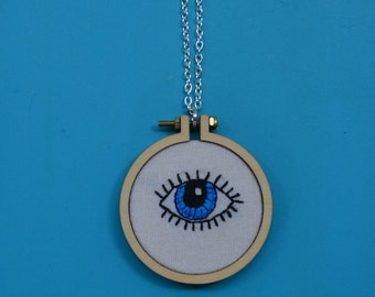 Embroidered necklace of an eye