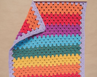 Handmade vintage style rainbow granny stripe crochet baby blanket in 100% recycled cotton