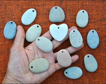 12 Beach Stone pendants and a White Heart stone-Top drilled natural pebbles fron the Adriatic Sea. Supply for rock painters (PE)
