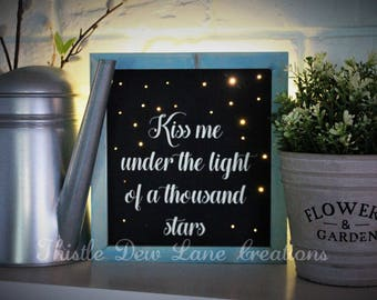 Kiss Me Under the Light of a Thousand Stars wood sign with lights, fairy lights, light up sign