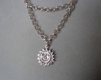 Happy / Sad face, silver pendant on chain.
