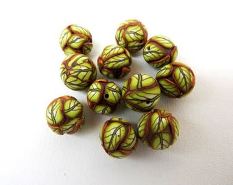I present you a lot 10 handmade polymer clay beads.