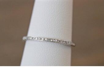 Single cut diamond half eternity band