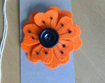Felt flower brooch in orange