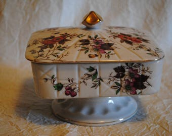 Ceramic Square pedestal candy dish with flower motif