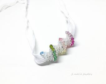 tourmaline color crystal spiral necklace .  crystal necklace . spiral necklace . white . silver .