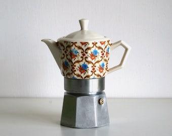 Vintage Italian moka pot with old-fashioned motif, upholstery decor