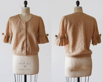 Mix it Up Cardigan / 1960s boucle knit sweater / ruffled sleeve bow sweater