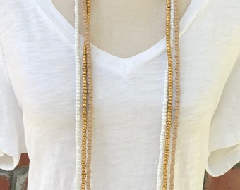 White, gold, tan long beaded necklace. Long gold and white hand beaded, triple strand necklace.