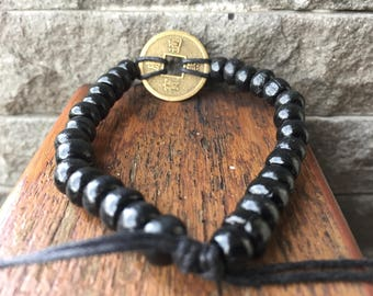 Wood beads stretch bracelet with Chinese coin charm, Indonesian Handmade Bracelet