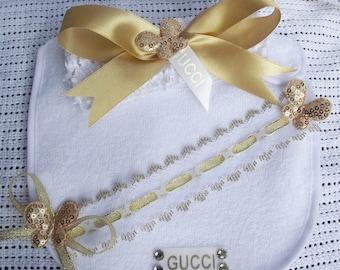 gold and white designer ribbon headband booties bib set