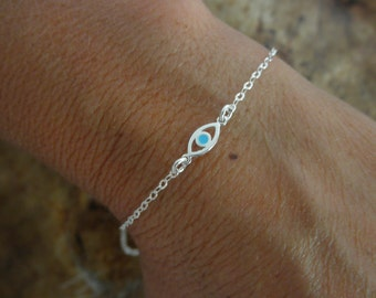 Evil eye bracelet with a touch of enamel sterling silver