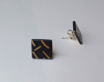 Oxidised silver earrings with 18 carat gold design