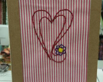 Hand embroidered card.