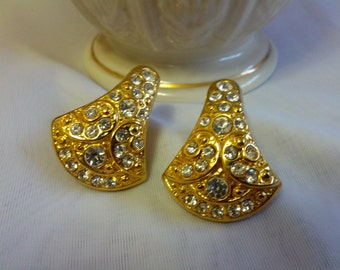 Beautiful gold tone metal clip on earrings with shiny rhinestones