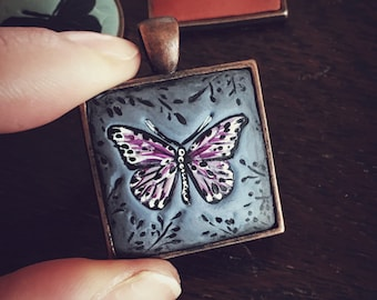 One Of A Kind ~ Hand Made Butterfly Pendent, in periwinkle clay, set in 1 inch, antiqued COPPER on 24 inch, copper chain.
