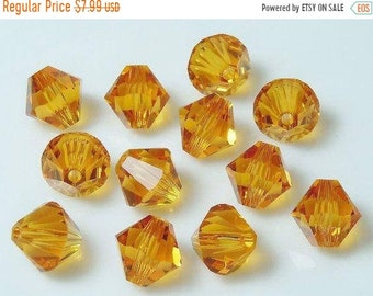 ON SALE 72  SWAROVSKI Crystal Top-Drilled BiCones in Topaz - 6mm