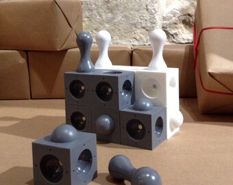 AXIOM is an abstract strategy game played in 3 dimensions   new colours   chess style
