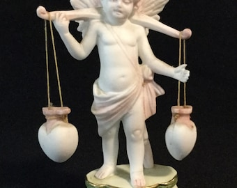 Antique Nineteenth Century German Bisque Porcelain Cupid Figurine