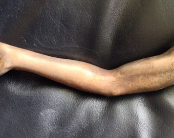 Right Arm Milagro Cast in Bronze
