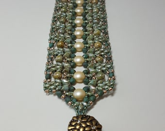 Wide  bracelet in shades of verdigris and green stone
