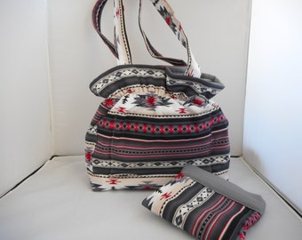 Aztec Southwest design shoulder purse; elastic top and magnetic snap for easy entry. Five pockets, plus a small bag for extra goodies.