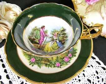 Regency tea cup and saucer courting couple love story center pattern signed teacup