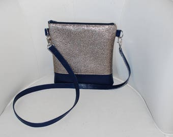 Navy blue leather handbag, faux leather shiny golden bronze.