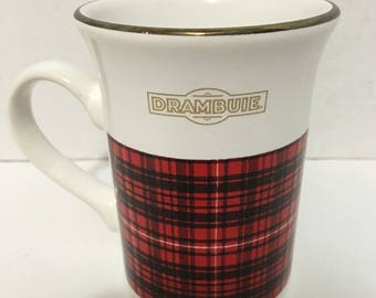 Vintage (1980s) Drambuie mug. Red and black Tartan, gold edge, Drambuie logo in gold. Made in England by Kiln Craft.