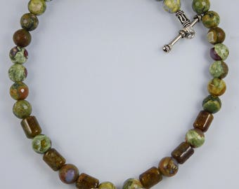 Round Faceted Rhyolite with Green Garnet and Hills Tribe Silver Leaf