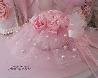 Elegant pouch shabby chic with ornament and beaded Pearl pink satin roses of romance.