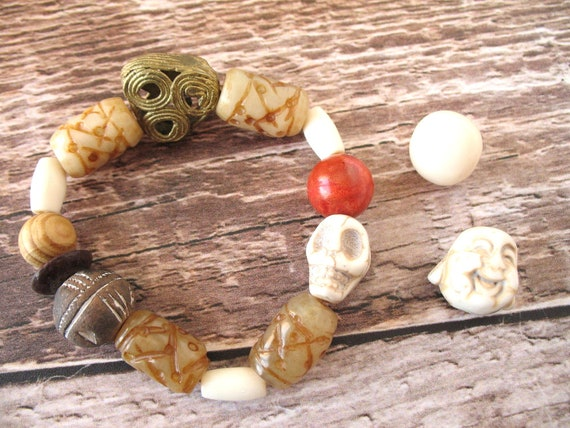 Chunky Bead Bracelet in Earthy Tones of Textured Jade, Polymer Clay, Coral, Bone, and Howlite Skull and Brass African Lost Wax Casting Beads