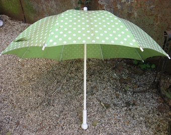 Rodier 1960s French Umbella Sun Parasol. Green cloth white polka dots. White plastic ball handle, wood stem. Carry clip cord. Made in France