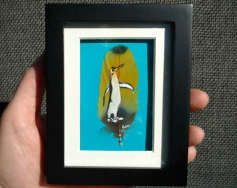 Tiny Penguin in Oxford Shoes Painting on Parrot Feather. Framed in Black, White, Teal. Original Eudora Welty Bird Miniature on Real Feather.