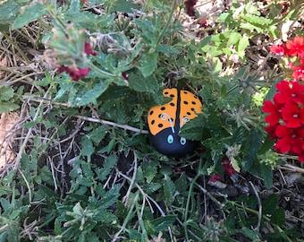 Hand painted orange ladybug garden rock