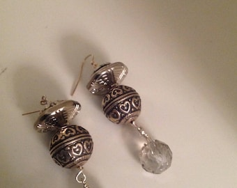 pierced, earrings with a focal bead from bali and a crystal bead at the bottom