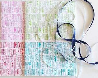Totem - double sided gift wrap wrapping paper in pink, fire engine red, seafoam and pale green. Perfect for Christmas and birthday gifts.