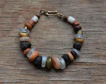 Trade bead bracelet with neolithic beads and raw garnet
