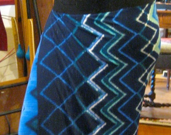 CUSTOM knit skirt is a faux wrap, wrapped panel is topped by stretch yoke