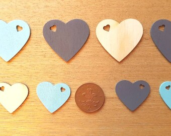 set of 8 various sized wooden hearts