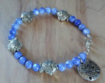 Blue shell with silver fish and sand dollar charm bracelet, vegetable dyed blue shell bracelet, fish bracelet, sand dollar charm bracelet